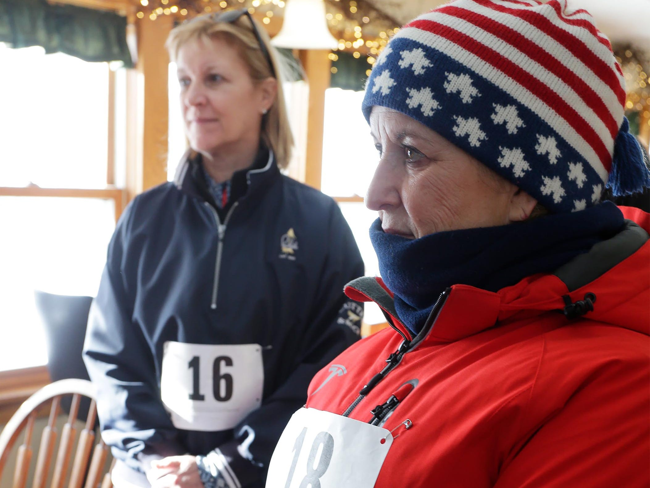 Mary Sellinger of Shorewood, Wis, (16 left), and Lisa Liebl (18) of Sheboygan, listen to pre-race instructions for the Schneelauf Run, Saturday, January 26, 2019, in Elkhart Lake, Wis.