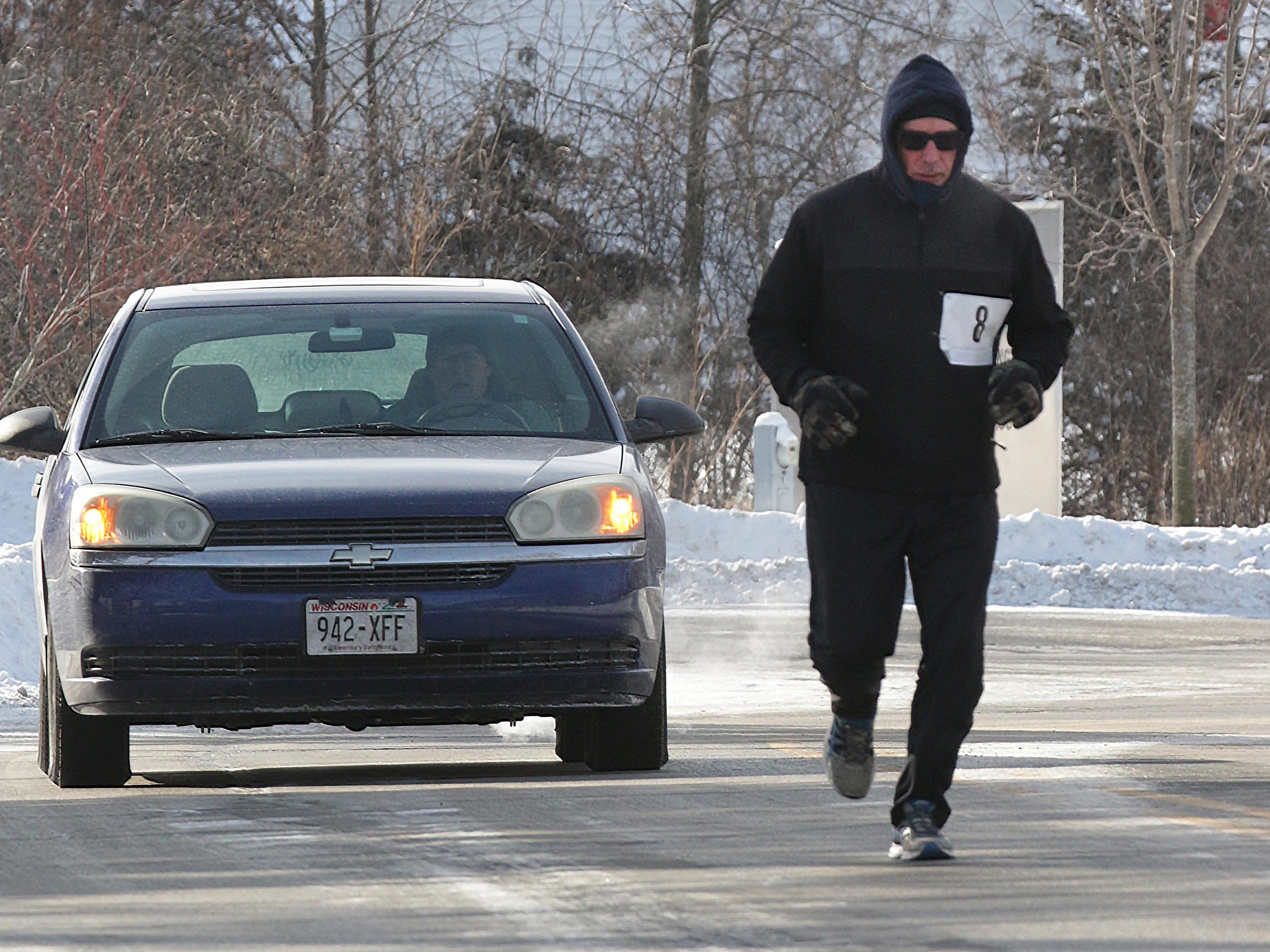 Matt O'Connor (8) of Plymouth, Wis., runs in the 2-miles Schneelauf Run, Saturday, January 26, 2019, in Elkhart Lake, Wis. The event is part of Schnee Days in Elkhart Lake. O'Connor's time was 18:55 at the event.
