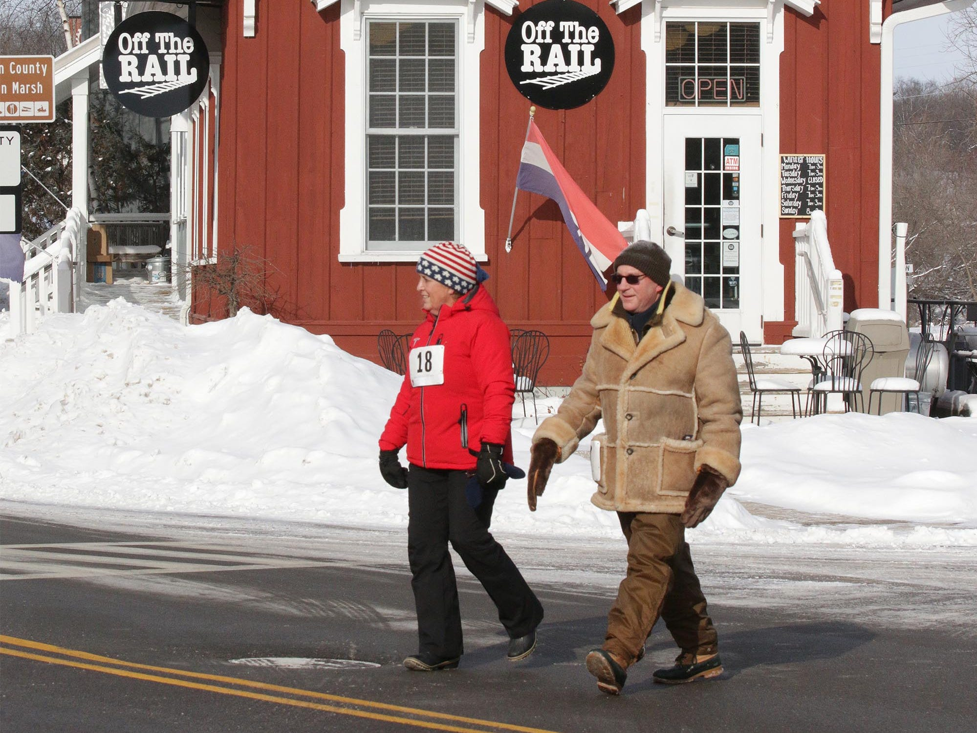 Thomas, left, and Lisa Liebl of Sheboygan, Wis., participate in the 2-miles walk/run Schneelauf Run, Saturday, January 26, 2019, in Elkhart Lake, Wis.