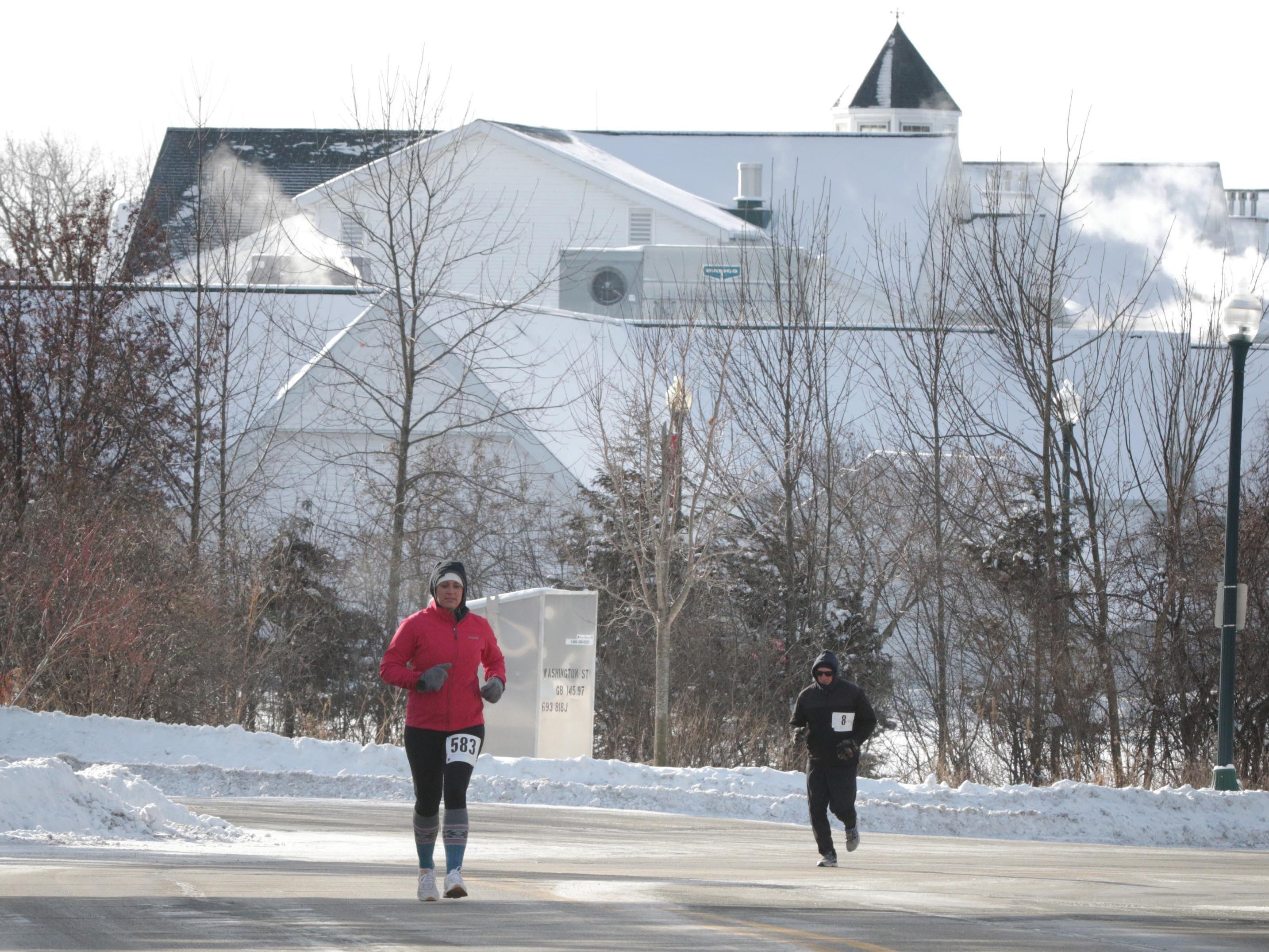 Jenna Schram (583) of Elkhart Lake and Matt O' Connor of Plymouth, Wis. run during the 2-miles Schneelauf Run, Saturday, January 26, 2019, in Elkhart Lake, Wis.