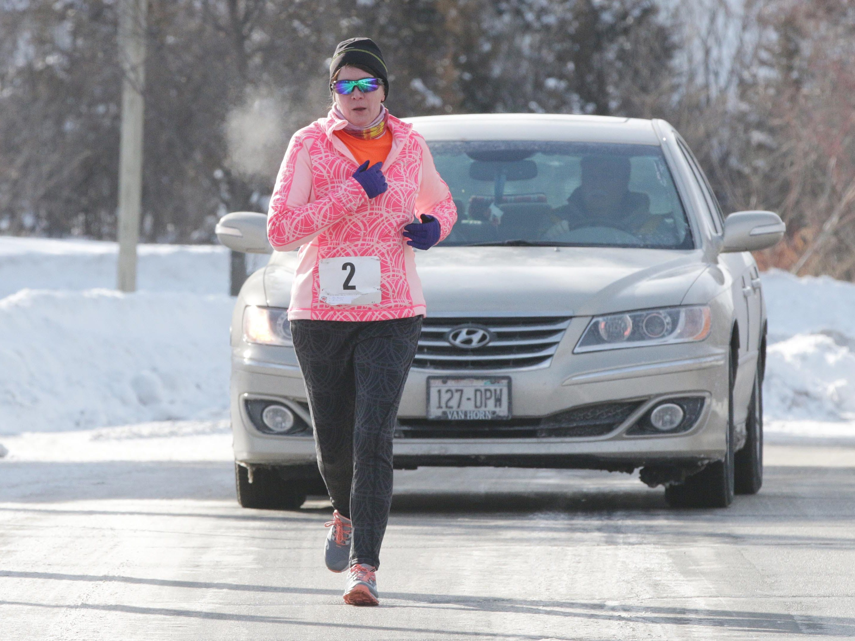 Jan Bennin (2) of New Holstein, Wis., runs the 2-mile Schneelauf Run, Saturday, January 26, 2019, in Elkhart Lake, Wis. The event is part of Schnee Days in Elkhart Lake. Bennin's time was 20:40 for the event.