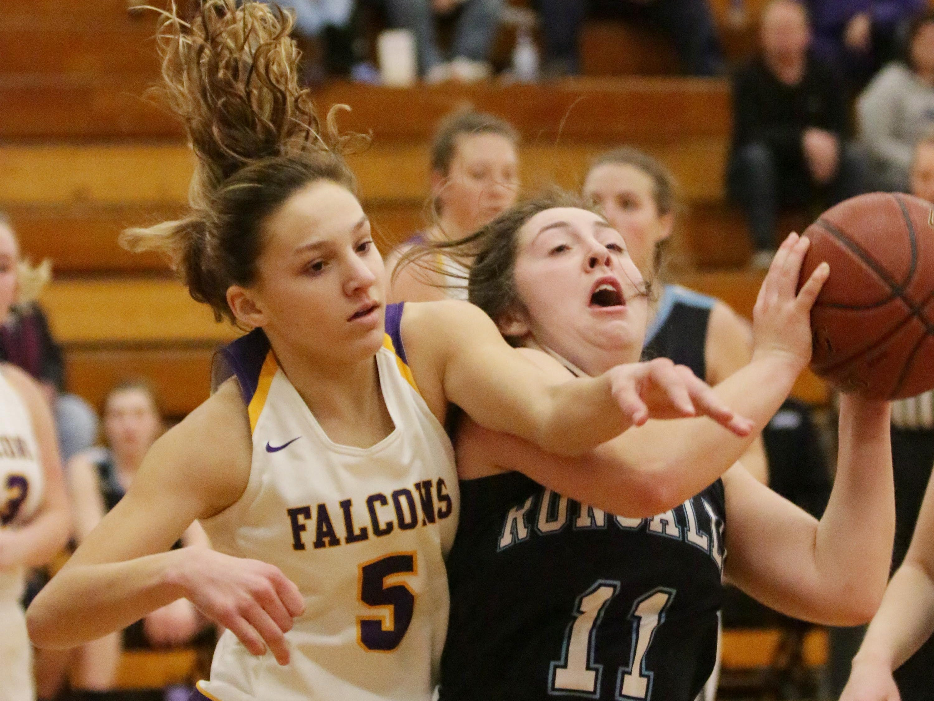Sheboygan Falls' Madelaine Specht (5) and Roncalli's Abby Stelzer (11) battle for the ball, Friday, January 25, 2019, in Sheboygan Falls, Wis.