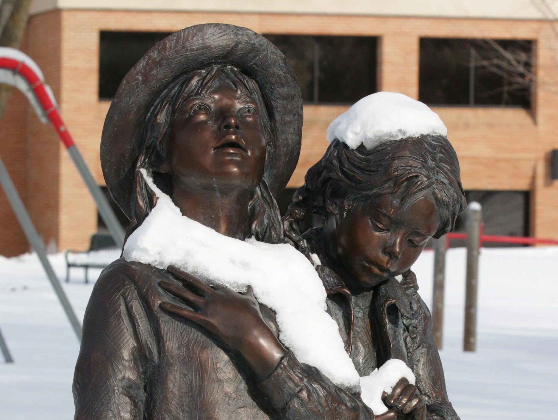 Bronze statues in Elkhart Lake are glazed with snow and ice, Saturday, January 26, 2019, in Elkhart Lake, Wis.