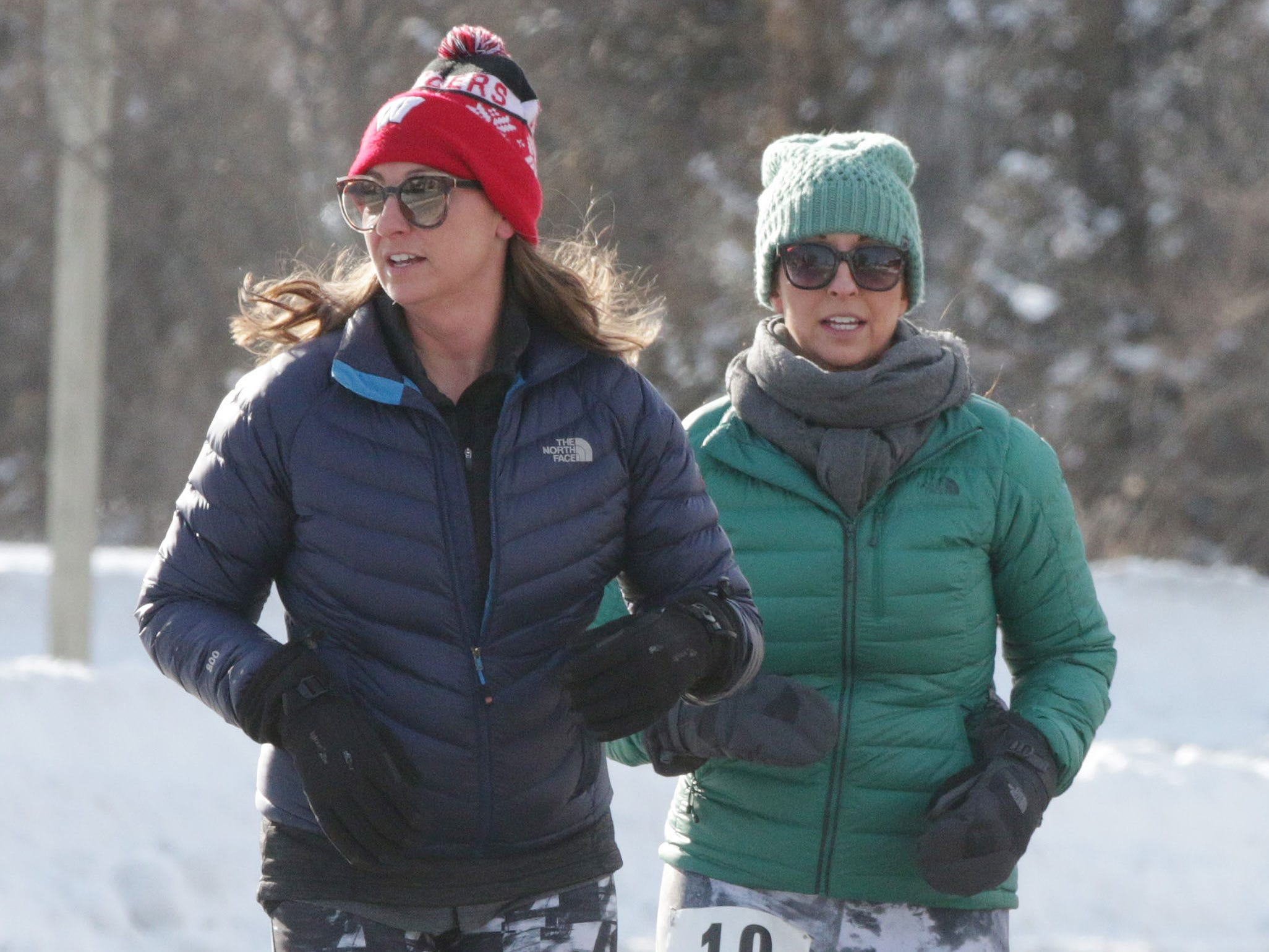 Sarah Dezwarte of Elkhart Lake (131, left) and Tonie Becker (19) run the 2-miles Schneelauf Run, Saturday, January 26, 2019, in Elkhart Lake, Wis. The event is part of Schnee Days in Elkhart Lake. Dezwarte's time was 23:33 and Becker's time was 23:35