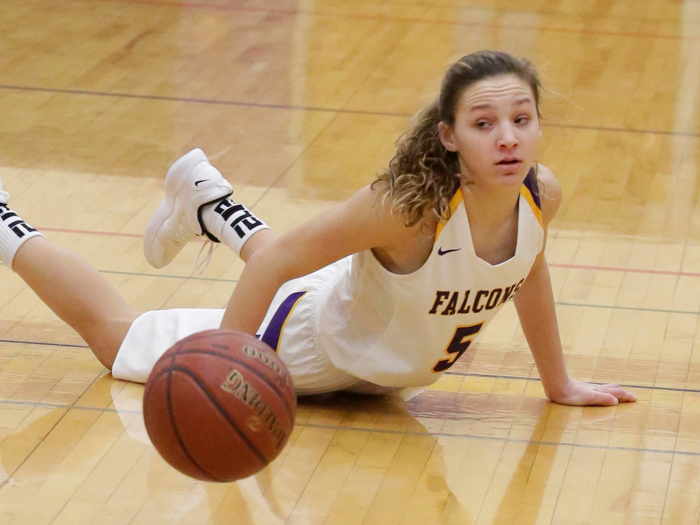 Sheboygan Falls' Madelaine Specht (5) looks at the loose ball during action with Roncalli, Friday, January 25, 2019, in Sheboygan Falls, Wis.