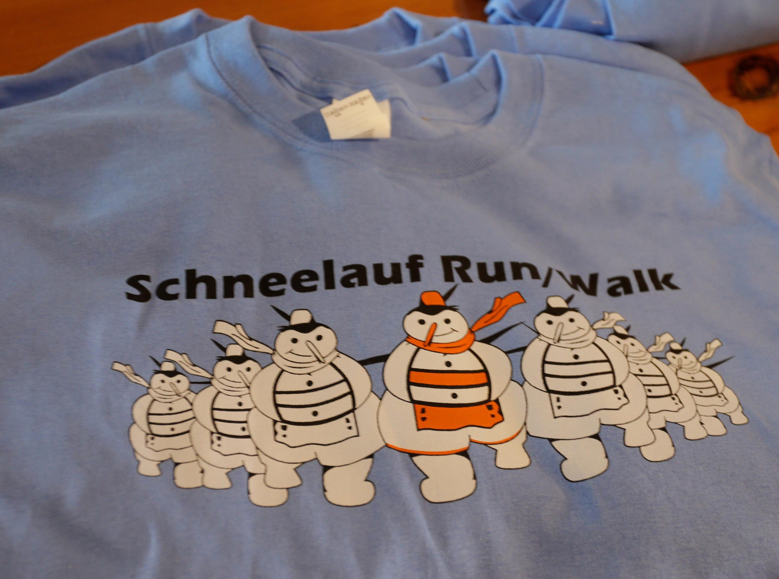 A commemorative piece of clothing on display and for sale at the Schneelauf Run, Saturday, January 26, 2019, in Elkhart Lake, Wis.