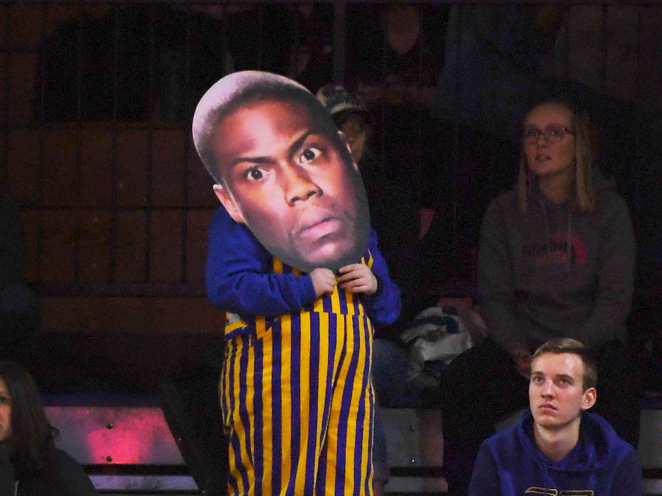 An SDSU student holds up a cutout of Chris Rock during the game against Omaha Saturday, Jan. 26, at Frost Arena in Brookings.