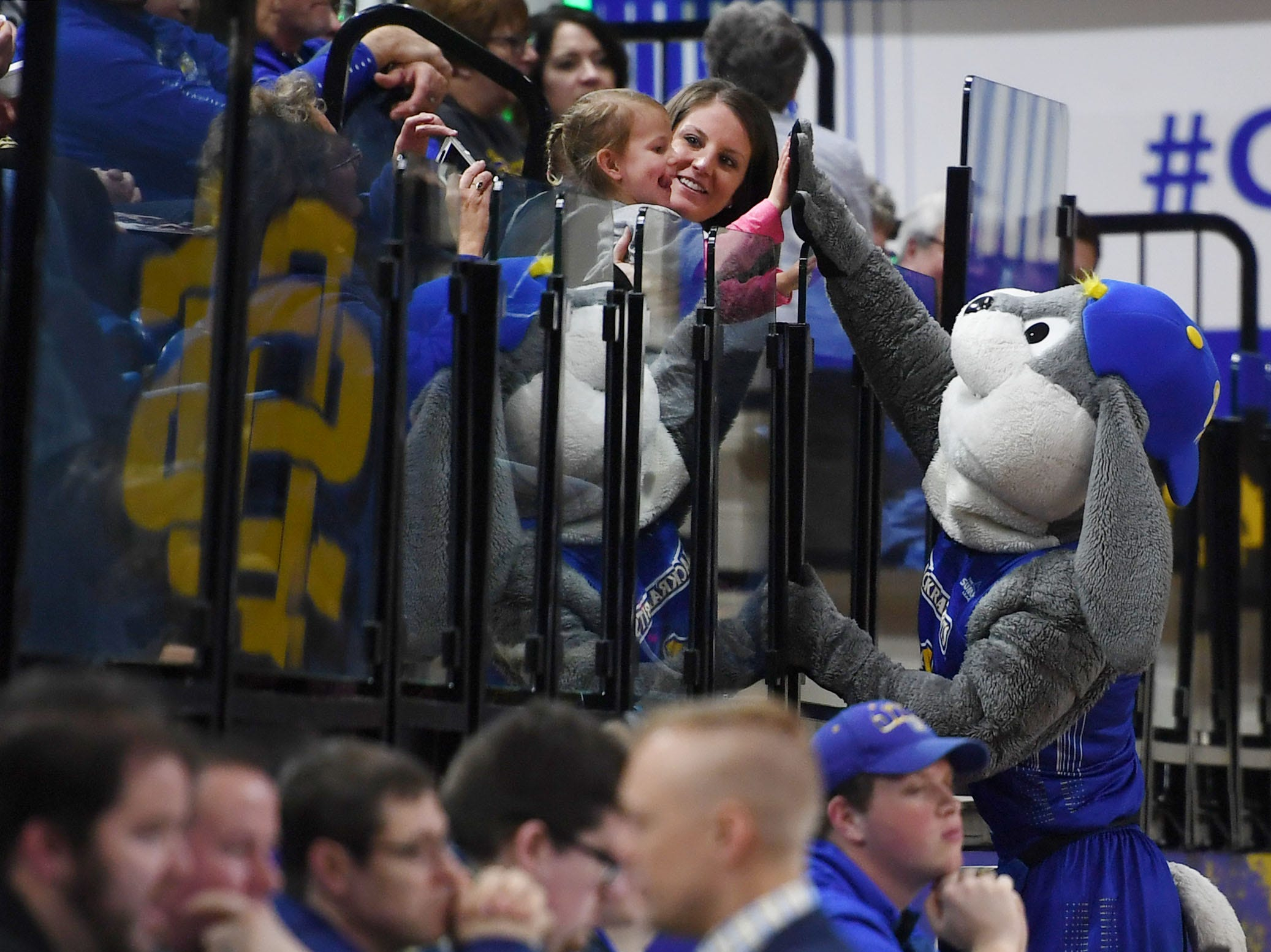 SDSU's Jack the Jackrabbit high fives a young fan before the game against Omaha Saturday, Jan. 26, at Frost Arena in Brookings.