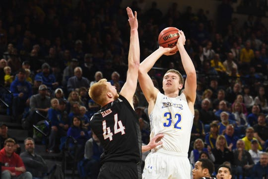 SDSU's Matt Dentlinger takes the shot against Omaha defense during the game Saturday, Jan. 26, at Frost Arena in Brookings.