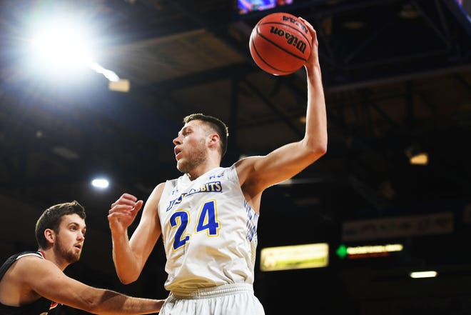 SDSU's Mike Daum goes against Omaha's Brett Barney during the game Saturday, Jan. 26, at Frost Arena in Brookings.