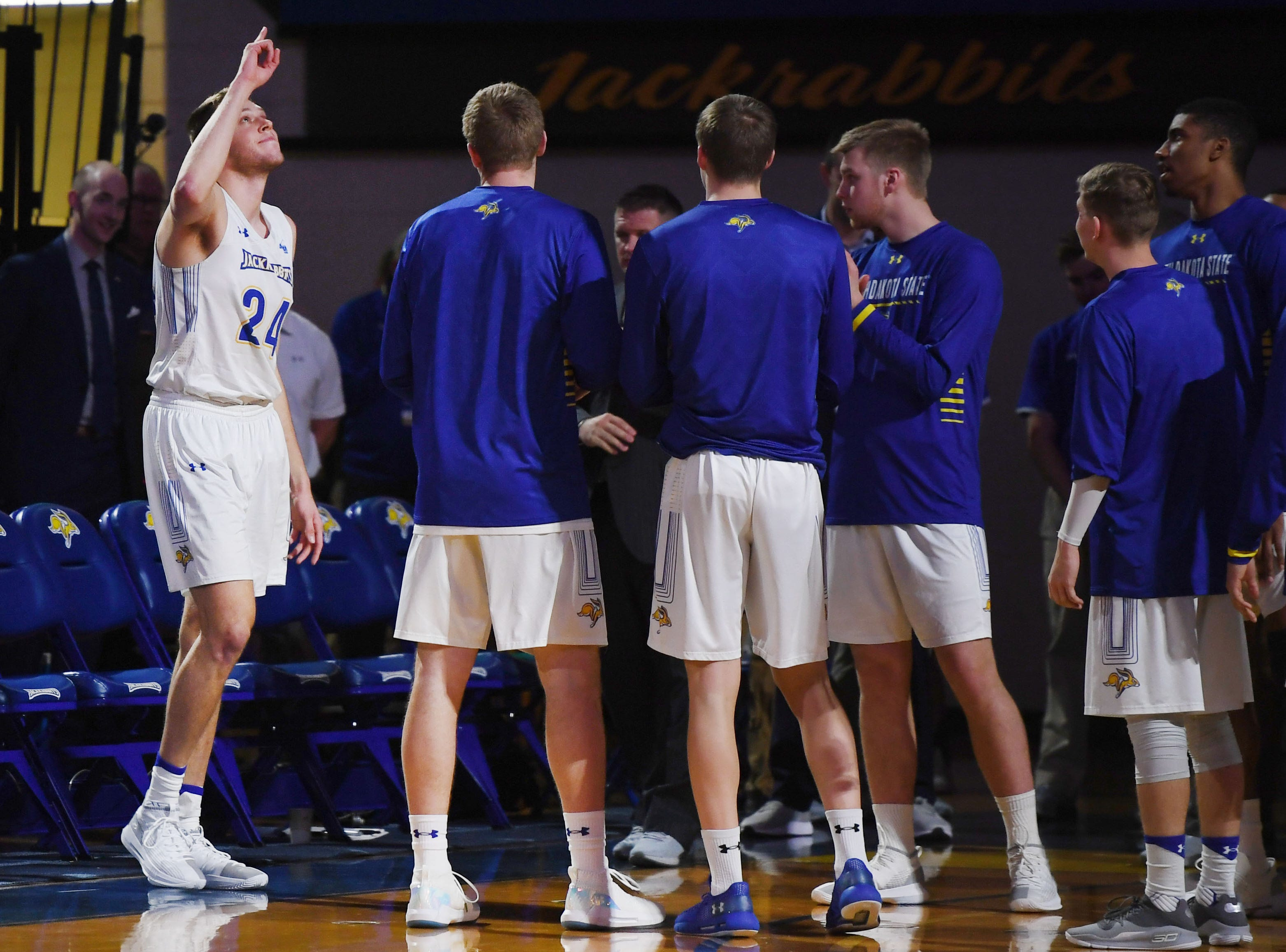 SDSU's Mike Daum points to the sky as he takes the court for the game against Omaha Saturday, Jan. 26, at Frost Arena in Brookings. SDSU won 83-73 against Omaha.