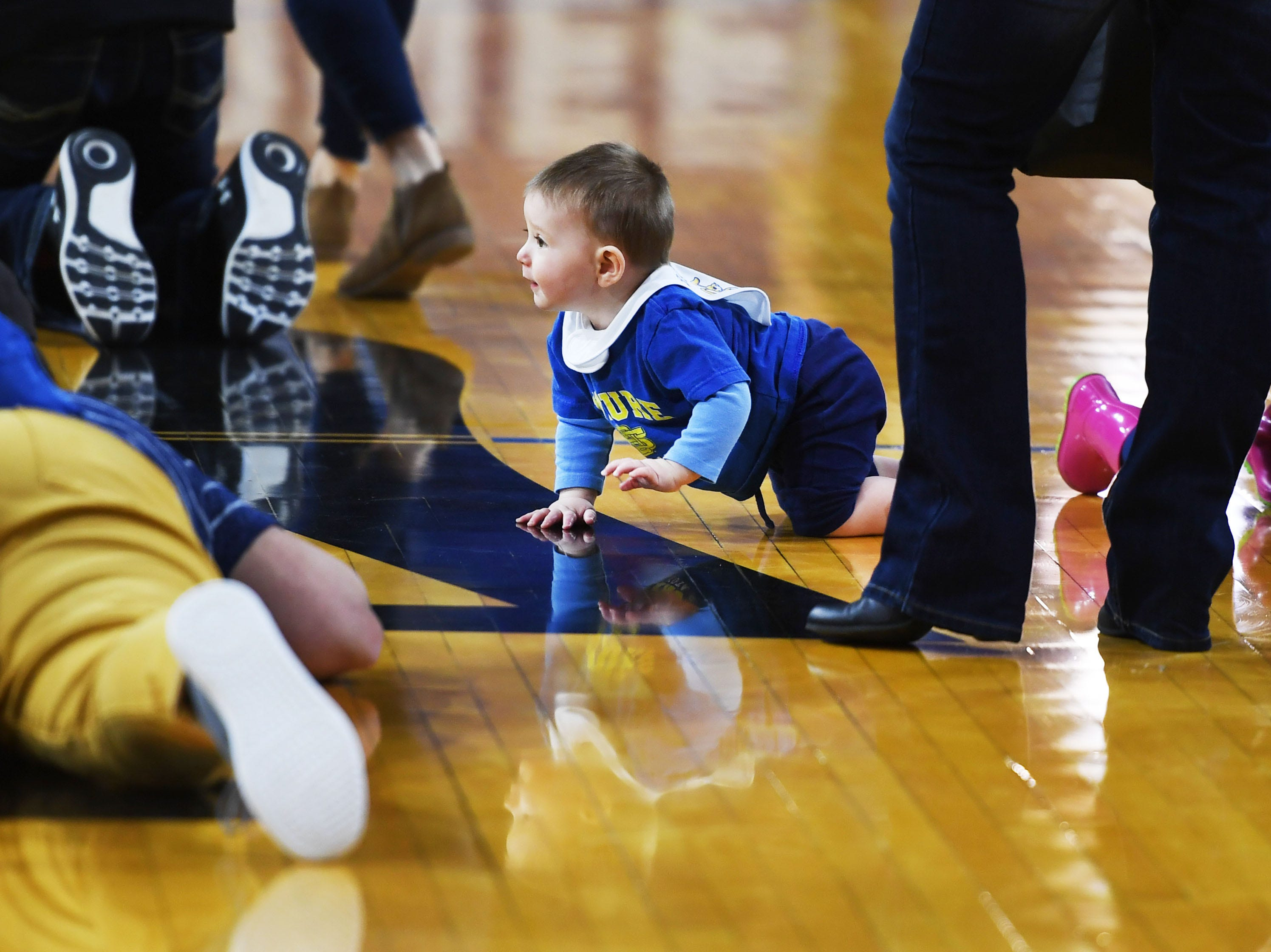 SDSU fans participate in a baby crawl race at half time during the game against Omaha Saturday, Jan. 26, at Frost Arena in Brookings.