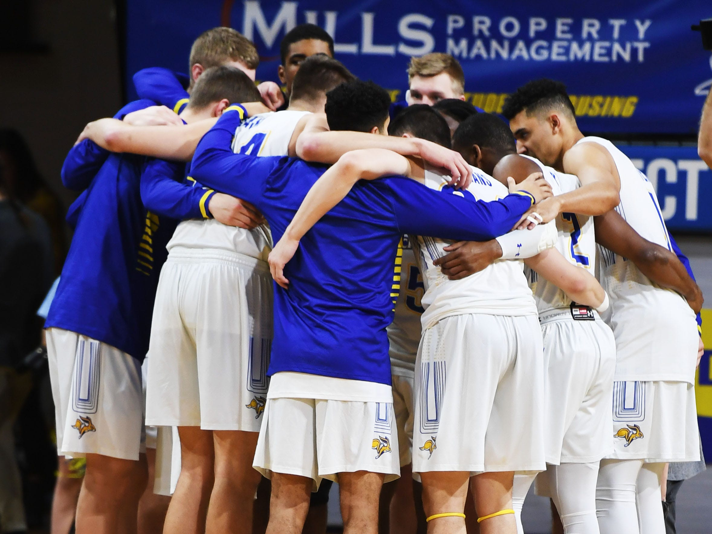 SDSU gets in a huddle before the game against Omaha Saturday, Jan. 26, at Frost Arena in Brookings.