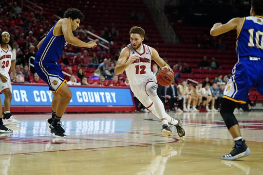 South Dakota forward Trey Burch-Manning drives towards the basket against Western Illinois on Saturday, Jan. 26, 2019 at the SCSC.