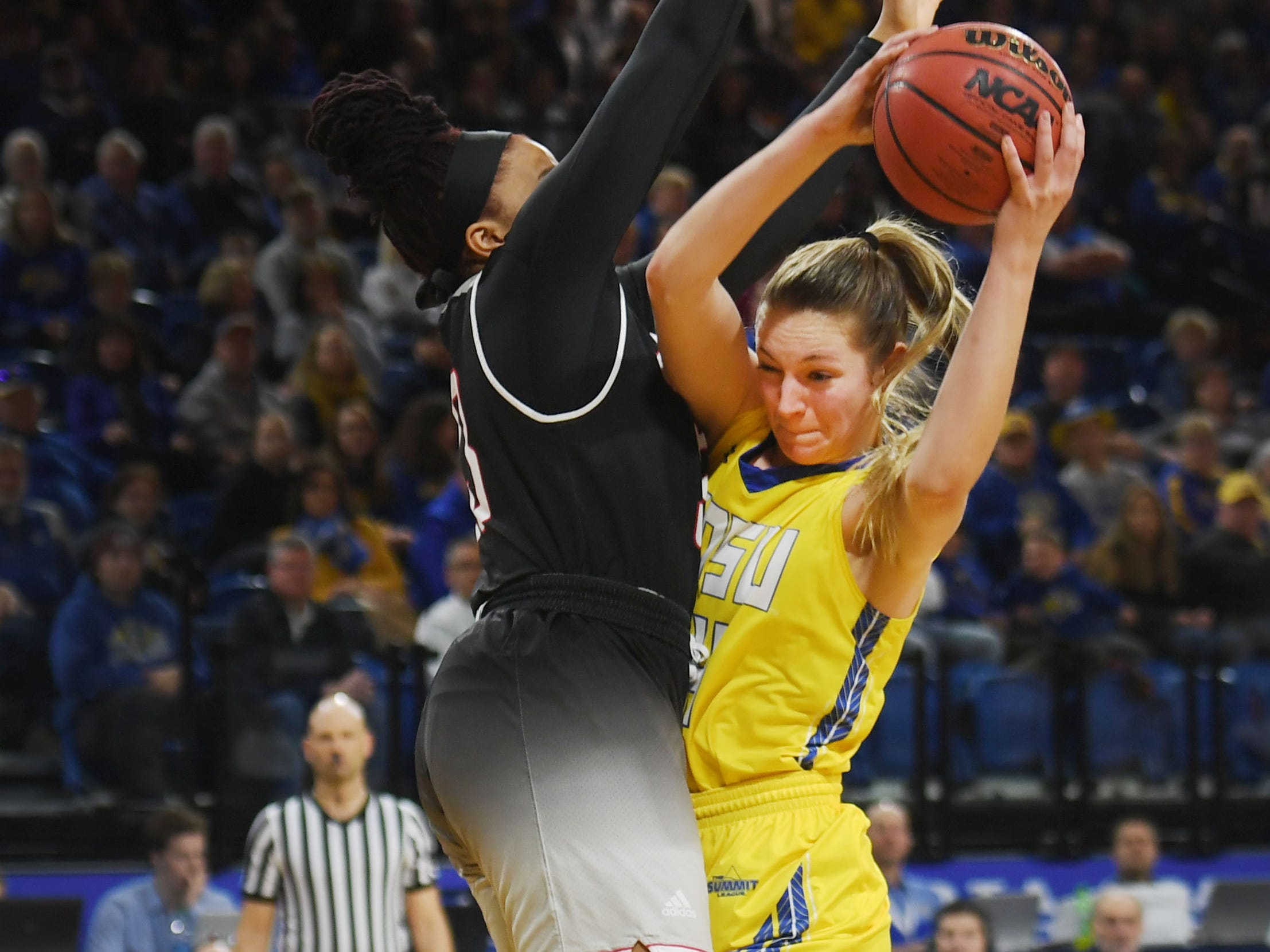 SDSU's Tagyn Larson goes against Omaha defense during the game Saturday, Jan. 26, at Frost Arena in Brookings.