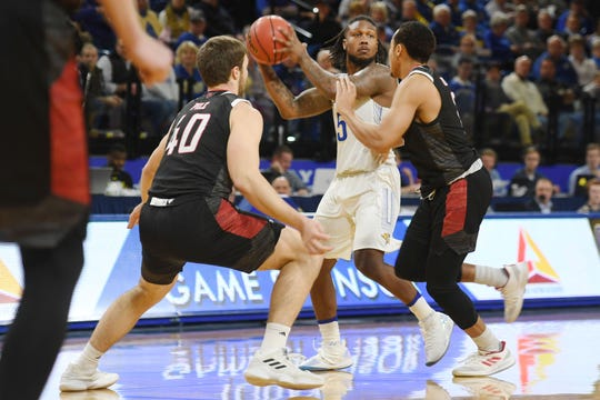 SDSU'sDavid Jenkins goes against Omaha defense during the game Saturday, Jan. 26, at Frost Arena in Brookings.