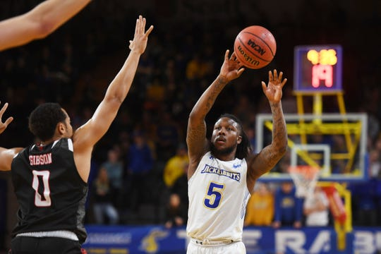 SDSU's David Jenkins goes against Omaha defense during the game Saturday, Jan. 26, at Frost Arena in Brookings.