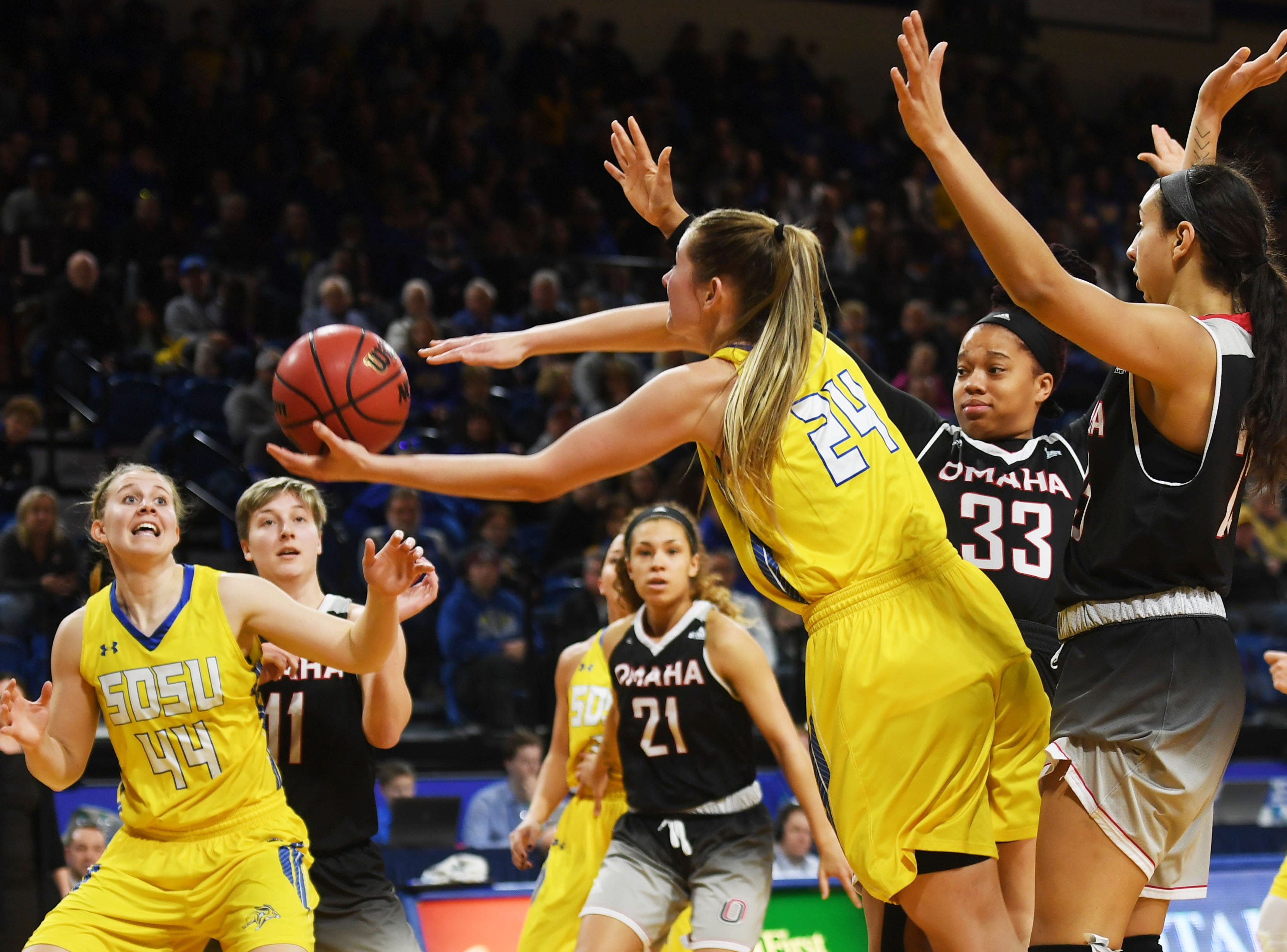 SDSU's Tagyn Larson (24) attempts to pass the ball to Myah Selland (44) under the net during the game against Omaha Saturday, Jan. 26, at Frost Arena in Brookings.