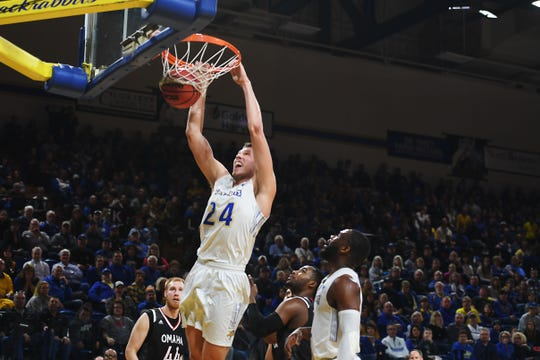 SDSU's Mike Daum dunks the ball during the game against Omaha Saturday, Jan. 26, at Frost Arena in Brookings.