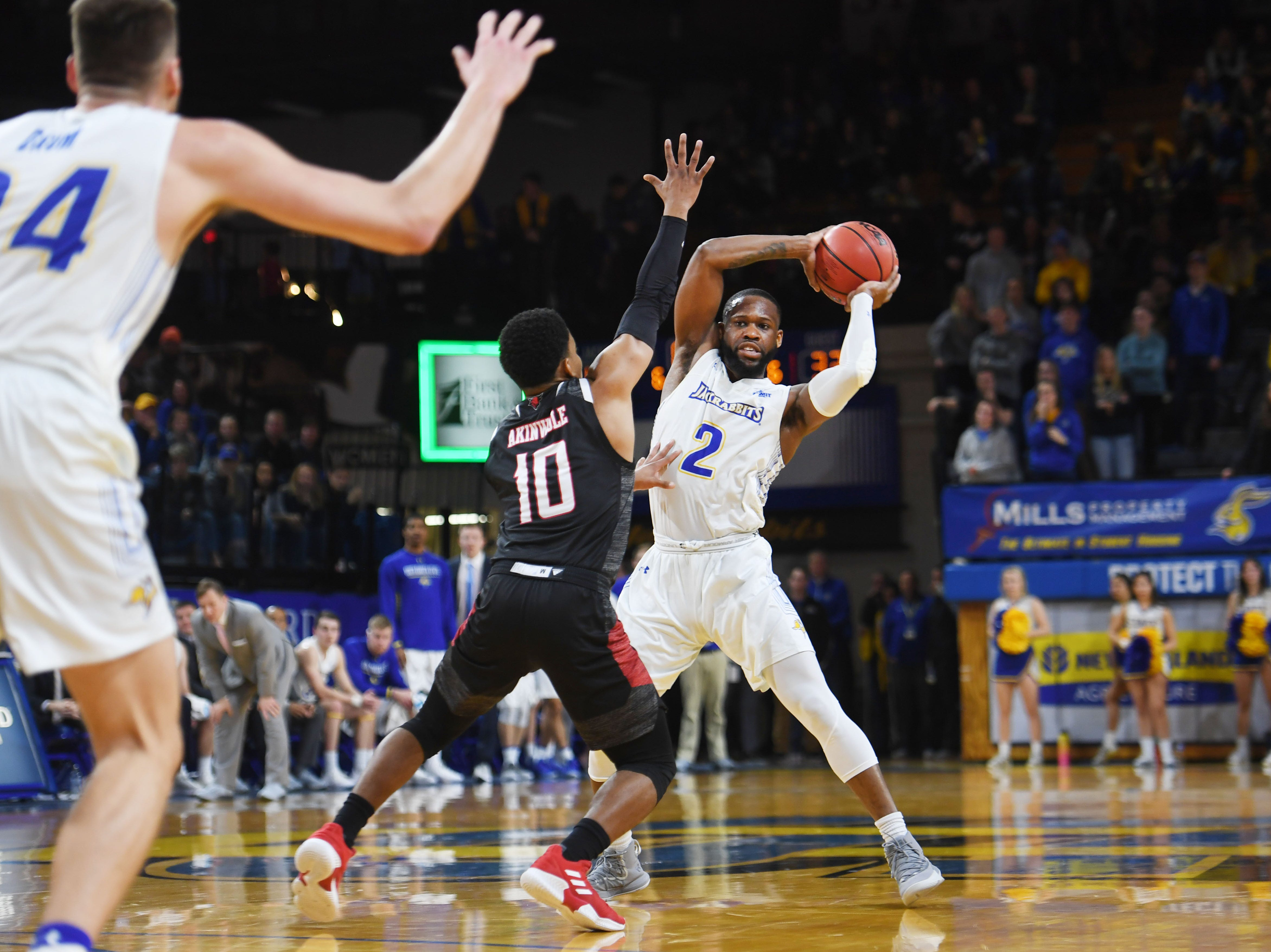 SDSU's Tevin King (2) looks to pass the ball to Mike Daum, far left, during the game against Omaha Saturday, Jan. 26, at Frost Arena in Brookings.