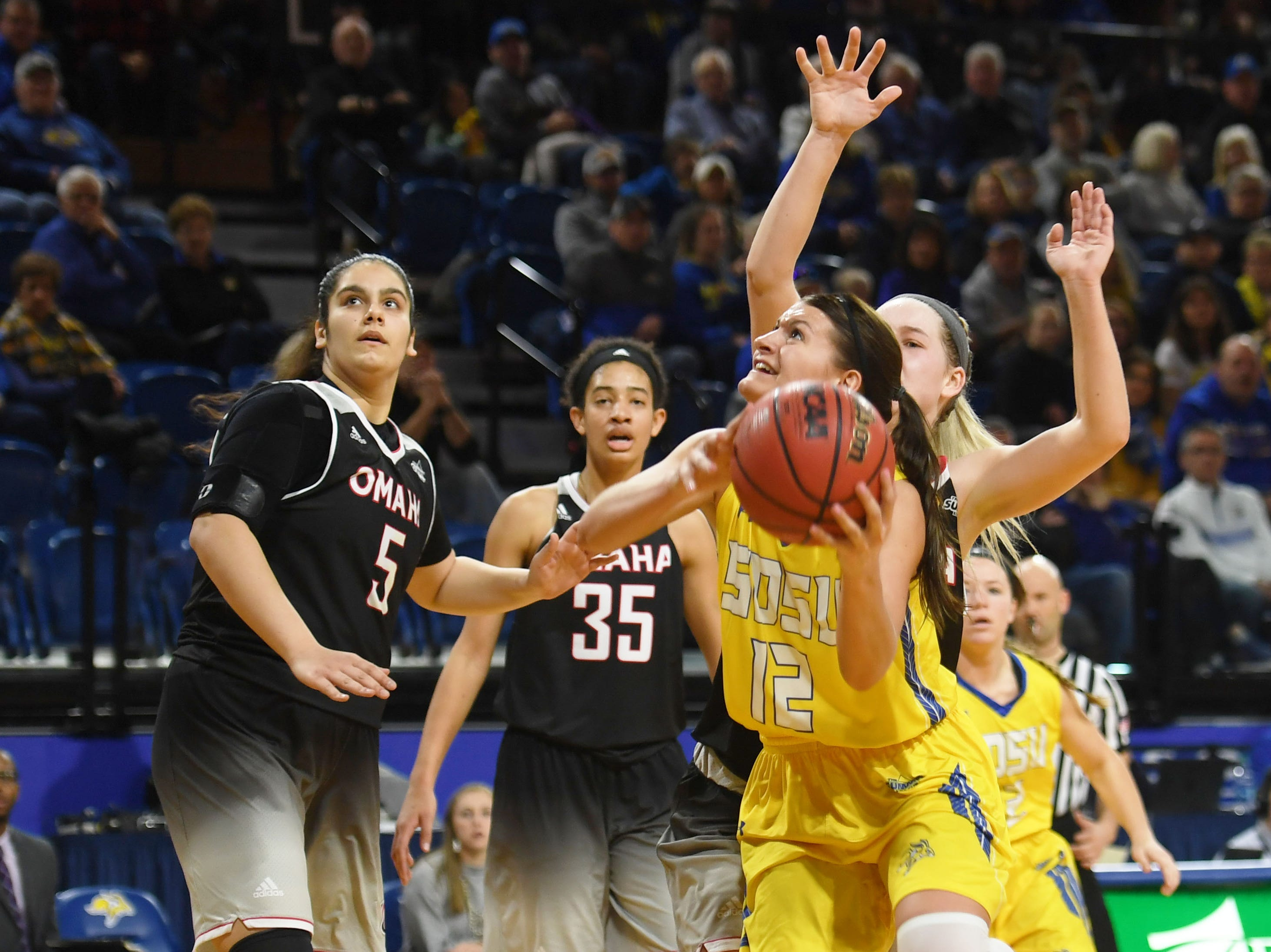 SDSU's Macy Miller attempts to score against Omaha during the game Saturday, Jan. 26, at Frost Arena in Brookings.