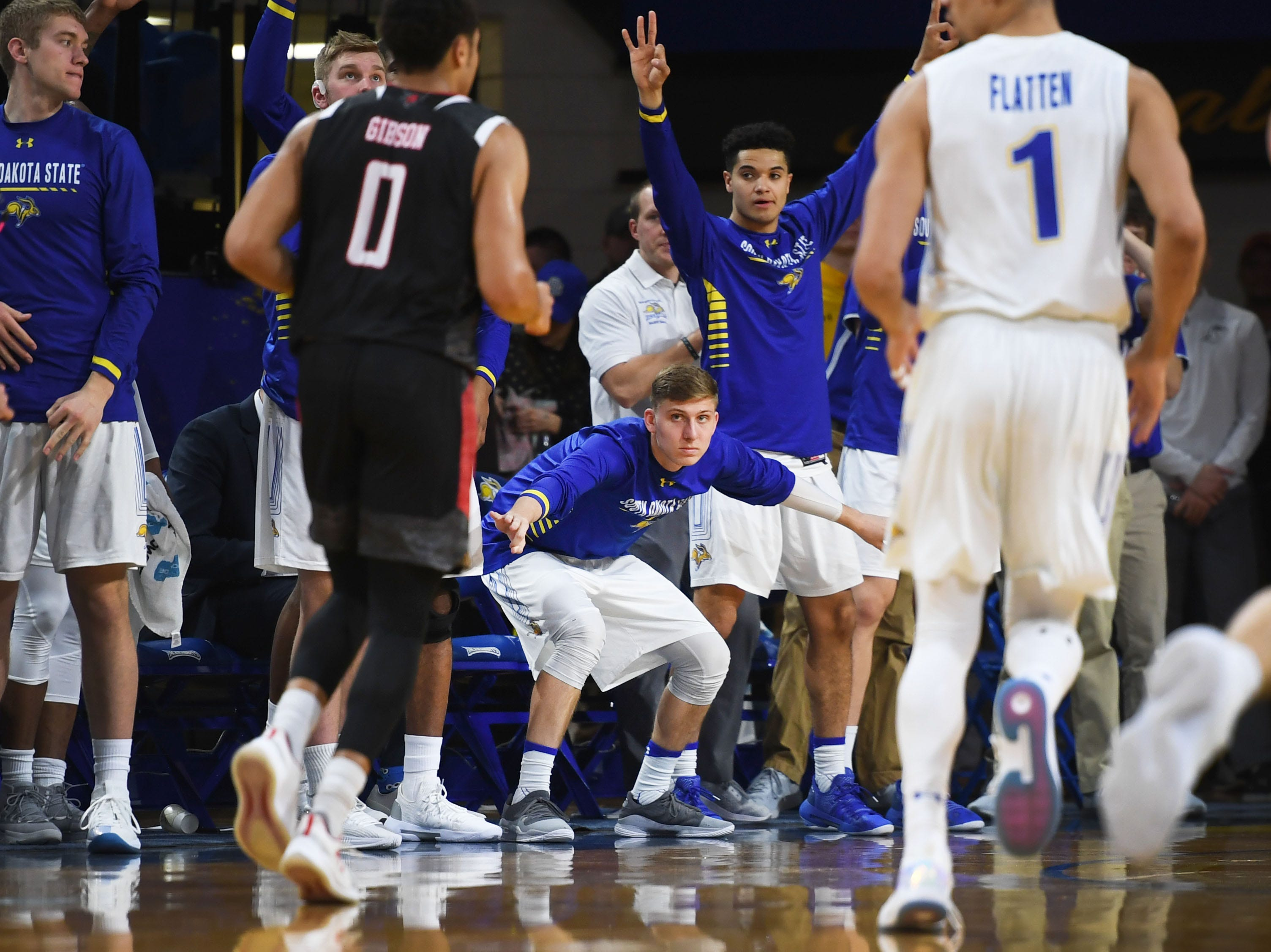 SDSU's sideline celebrates during the game against Omaha Saturday, Jan. 26, at Frost Arena in Brookings.