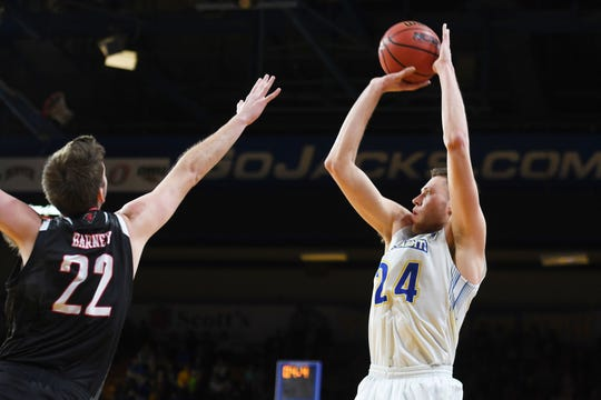 SDSU's Mike Daum takes the shot against Omaha defense during the game Saturday, Jan. 26, at Frost Arena in Brookings.