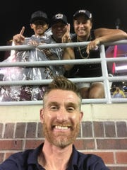 ESPN's Marty Smith takes a selfie with the Ramsey family during a college football game