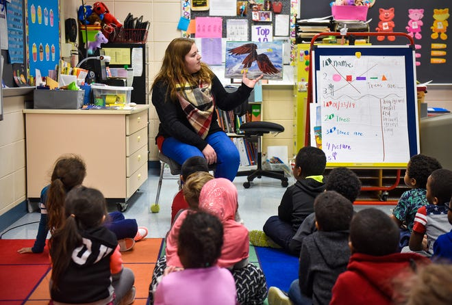 Teacher Samantha Backer goes through a book with kindergarten students Friday, Jan. 25, at Talahi Community School in St. Cloud. Backer is a permanent substitute teacher who fills in whenever Teachers On Call is unable to find a sub for Talahi.