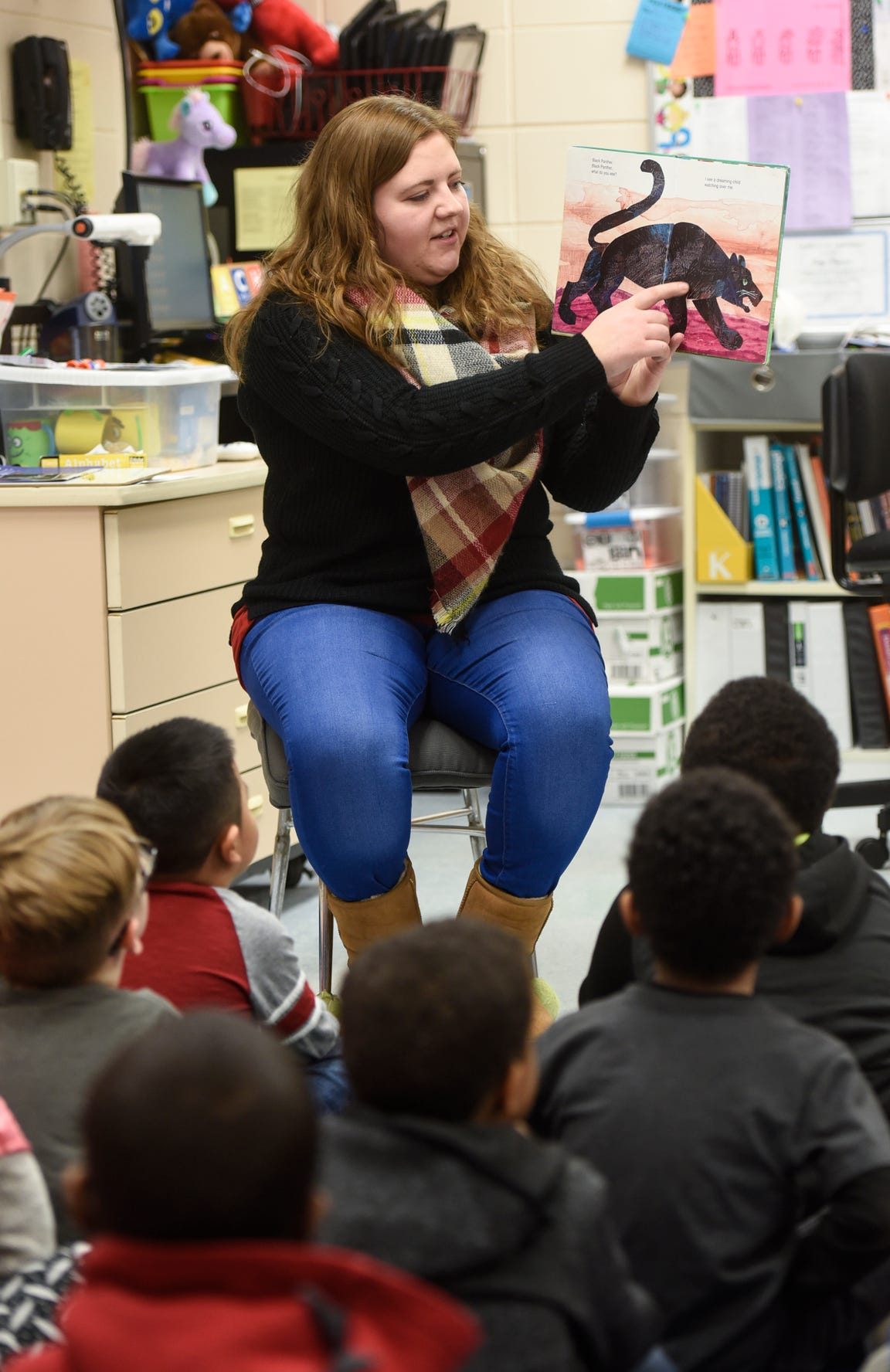 Samantha Backer goes through a book with kindergarten students Friday, Jan. 25, at Talahi Community School in St. Cloud. Backer is a permanent substitute teacher who fills in whenever Teachers On Call is unable to find a sub for Talahi.