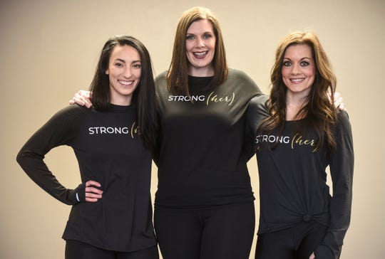 STRONG(her) event organizers Emma Schott, left, Julie Morse, center, and Dayna Deters are pictured Saturday, Jan. 26, at Integration Fitness in Waite Park.