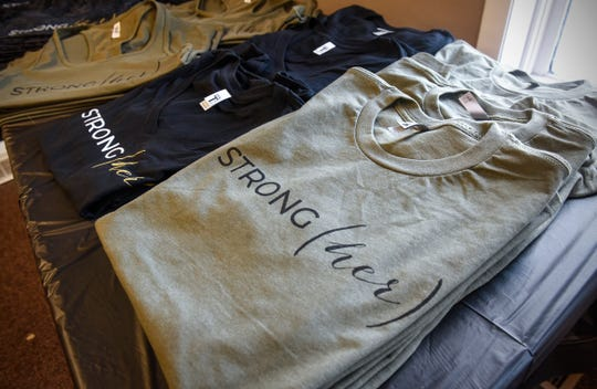 Merchandise for the upcoming STRONG(her) event is in place Saturday, Jan. 26, at Integration Fitness in Waite Park.
