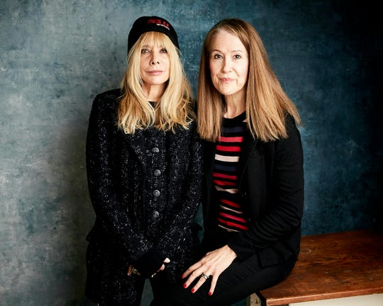 """Rosanna Arquette, left, and director Ursula Macfarlane pose for a portrait to promote the film """"Untouchable"""" at the Salesforce Music Lodge during the Sundance Film Festival on Saturday, Jan. 26, 2019, in Park City, Utah. (Photo by Taylor Jewell/Invision/AP)"""