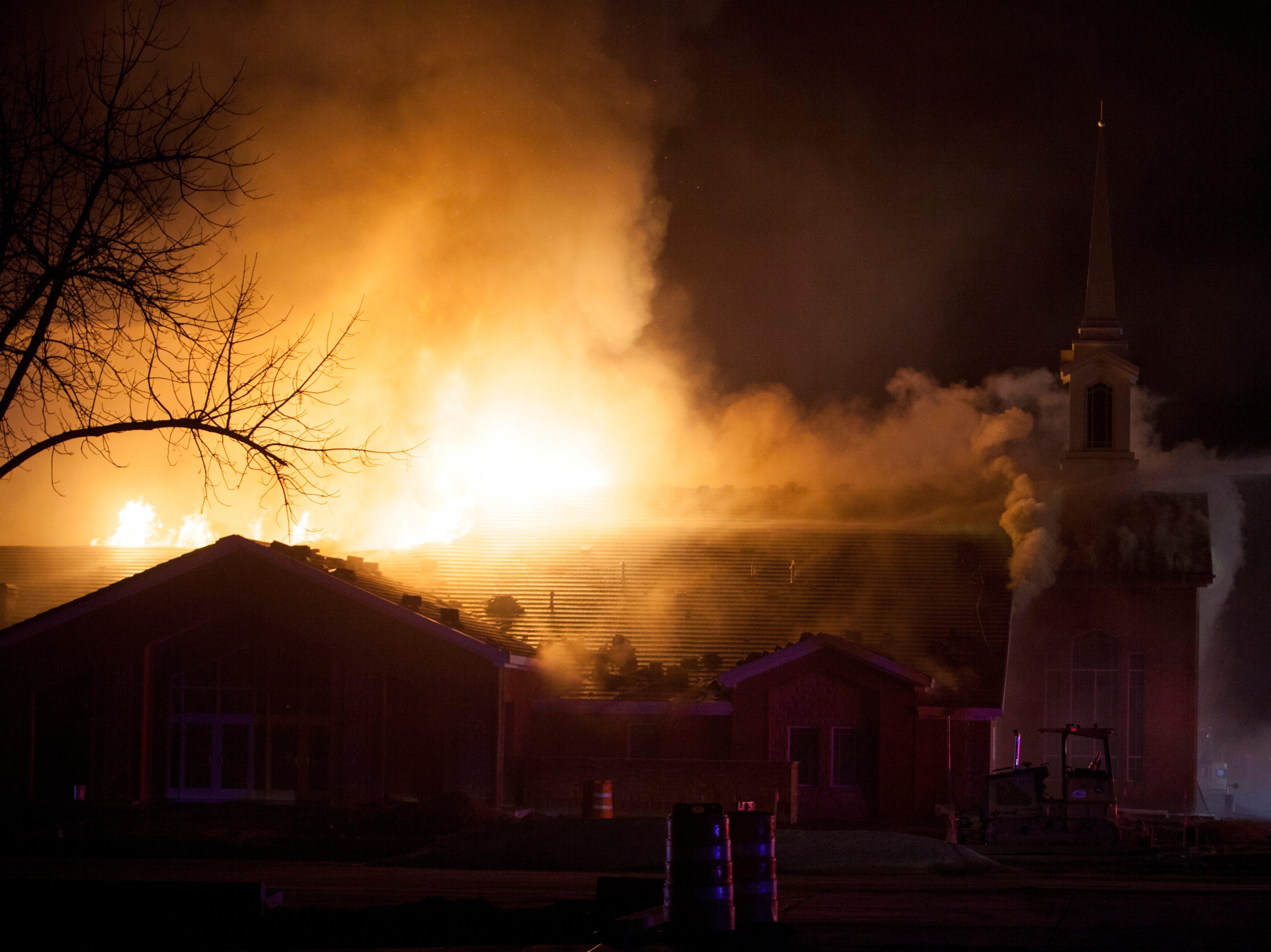 Fire departments from around the county work to control a fire at the recently-renovated LDS stake center Saturday, Jan. 26, 2019.