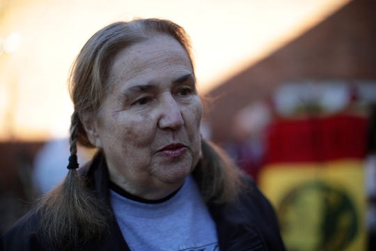Constance Clineman, a visitors services technician at St. Marks National Wildlife Refuge, talks about the impact of the government shutdown on her work at the refuge during a yard sale held at Unity Eastside Church to benefit federal workers furloughed during the government shutdown Saturday, Jan. 26, 2019.