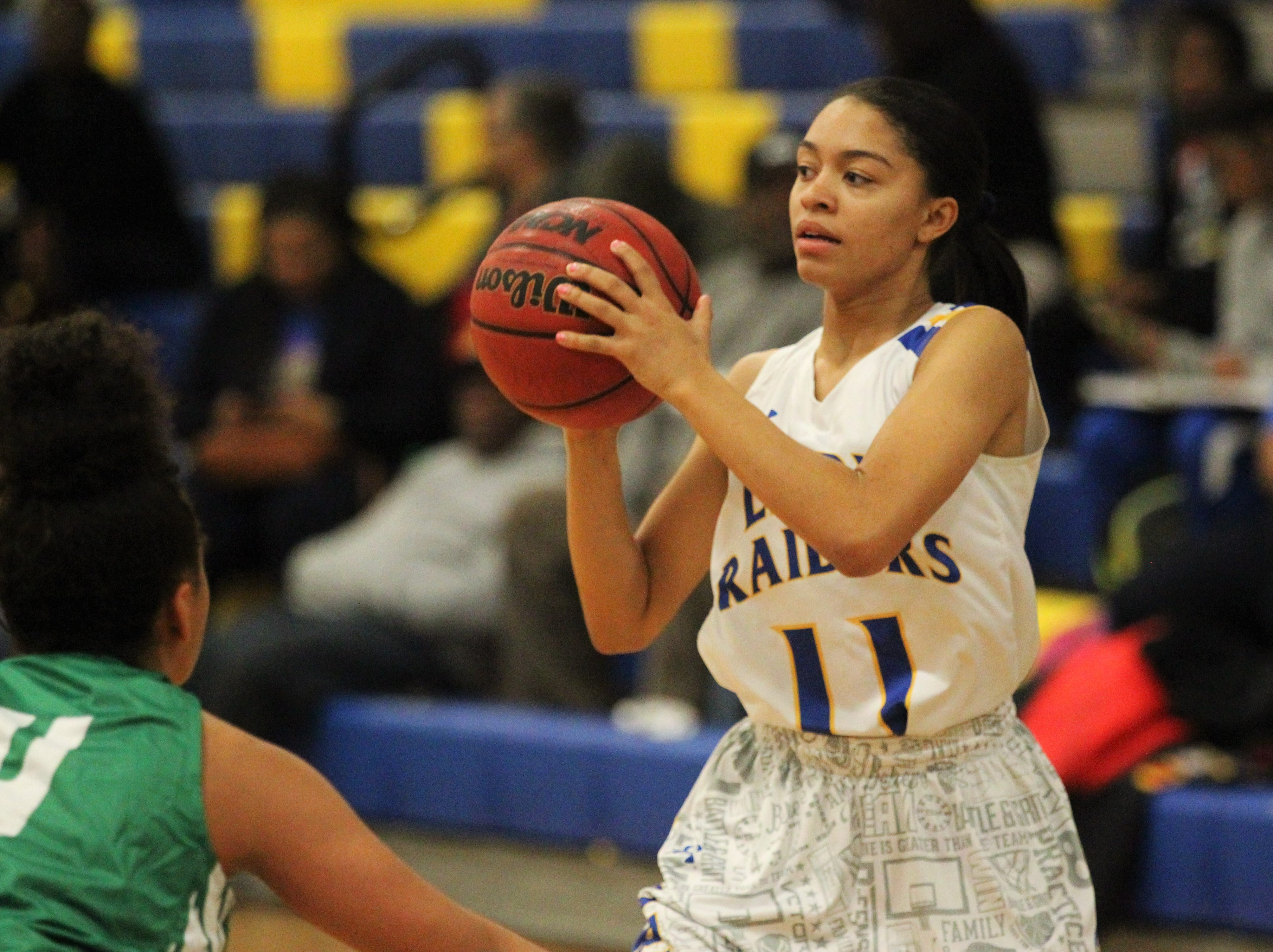 Rickards senior guard LaNiyah Lee looks for a pass as the Raiders beat Choctaw on Jan. 25, 2019.