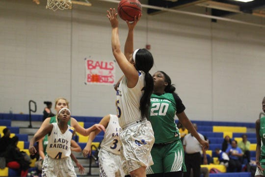 Rickards senior guard Victoria Smith goes up for a basket as the Raiders beat Choctaw on Jan. 25, 2019.