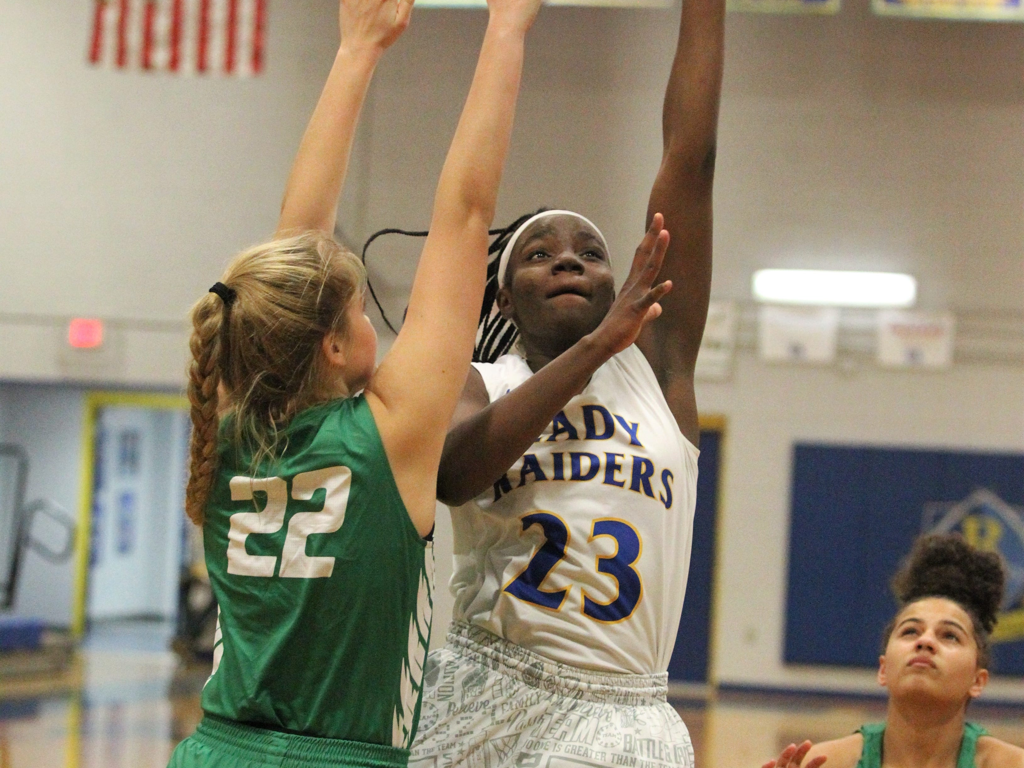 Rickards senior forward Renia Hawkins goes up for a basket in traffic as the Raiders beat Choctaw on Jan. 25, 2019.
