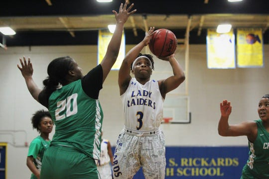Rickards senior guard Iyanla Woodfaulk hangs in the air for a shot in the paint as the Raiders beat Choctaw on Jan. 25, 2019.