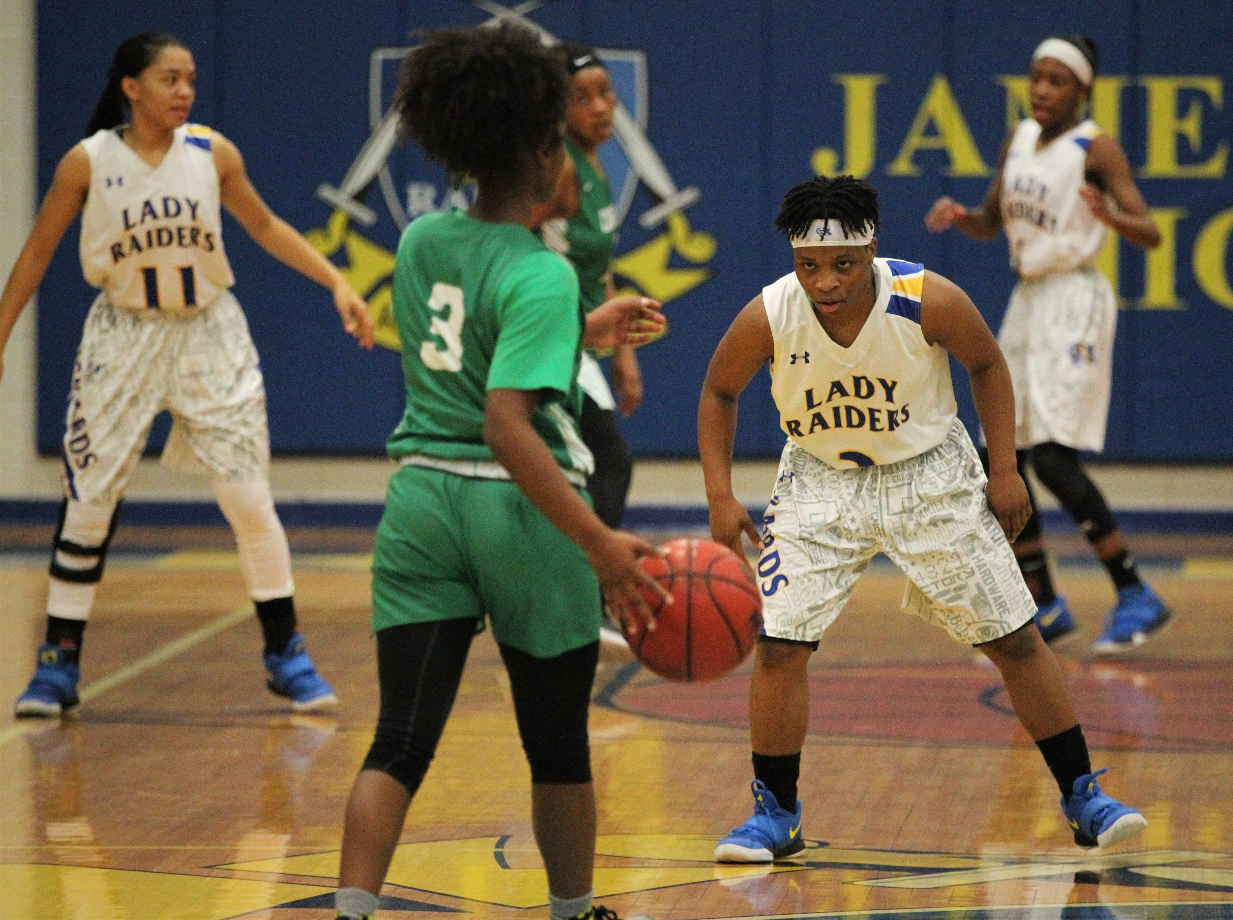 Rickards senior guard Iyanla Woodfaulk gets ready defensively as the Raiders beat Choctaw on Jan. 25, 2019.