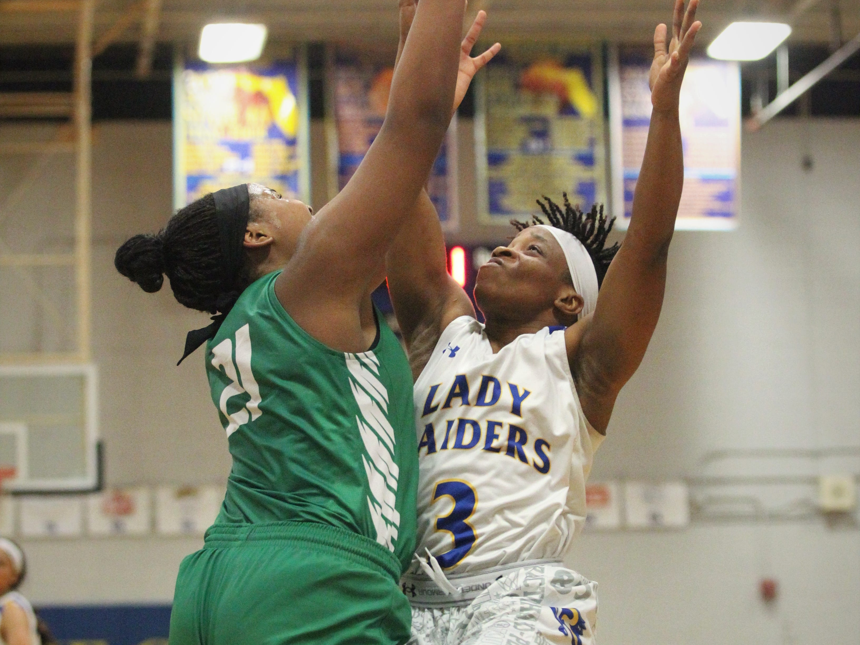 Rickards senior guard Iyanla Woodfaulk fights for a rebound as the Raiders beat Choctaw on Jan. 25, 2019.