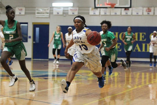 Rickards junior Ne'aysia Randall chases down a pass as the Raiders beat Choctaw on Jan. 25, 2019.