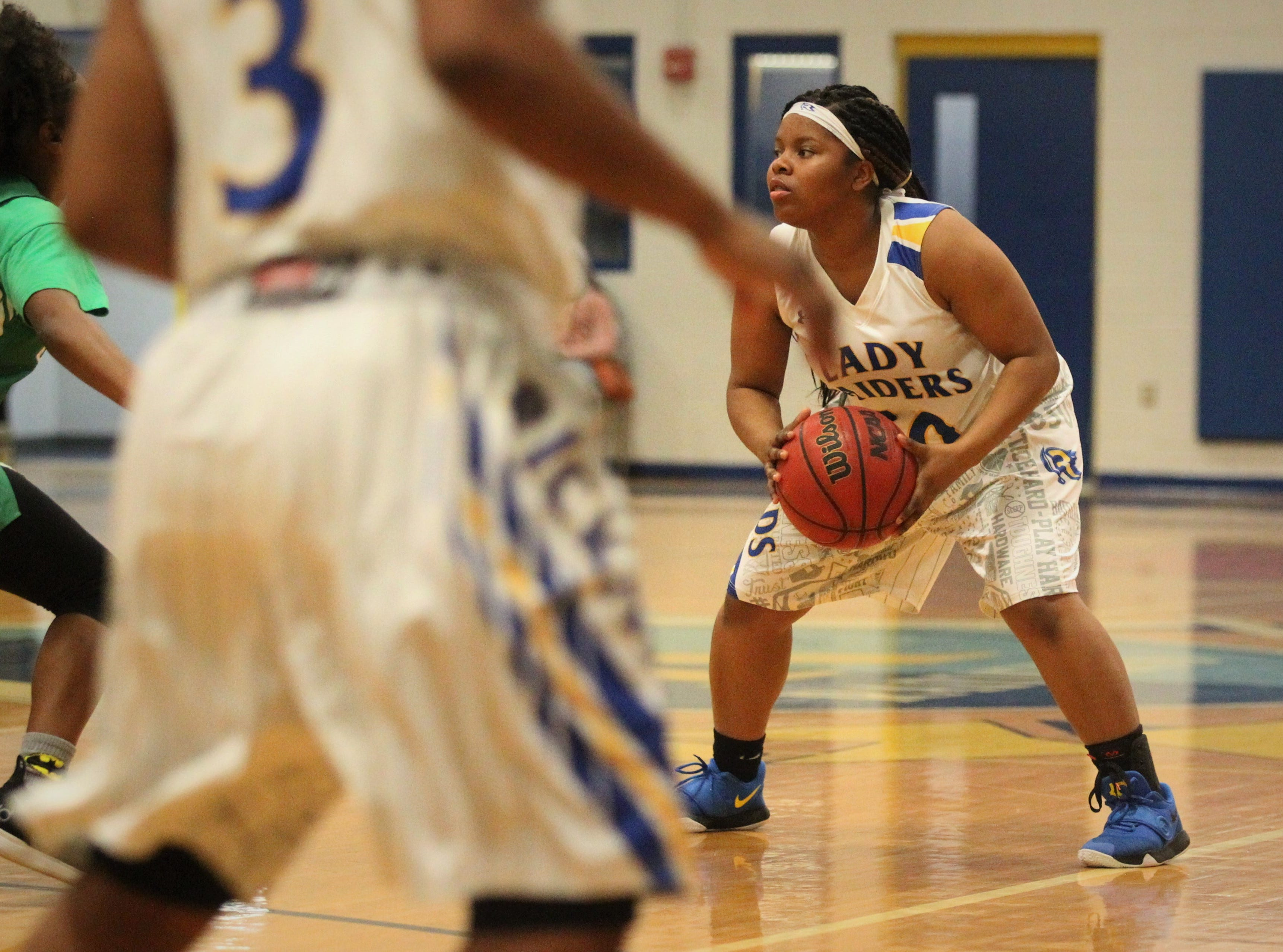 Rickards junior Ne'Aysia Randall looks for a pass as the Raiders beat Choctaw on Jan. 25, 2019.