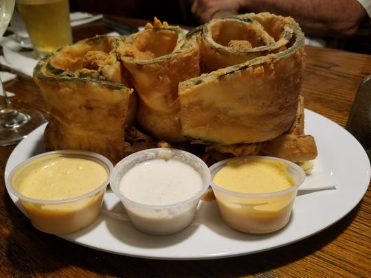 Bobby's Trio Loaf ($7.99), large bands of fried zucchini rolled on a bed of onion petals, stuffed with fried mushrooms.
