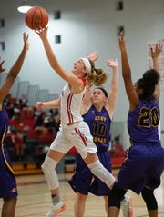 Centennial's Lindsey O'Sullivan puts a shot up against Fort Pierce Central in the first half of their game at Centennial High School on Friday, January 25, 2019 in Port St. Lucie.