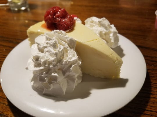 Incredibly dense, yet creamy, Bobby Rubino's cheesecake was served with a side of strawberry topping and whipped cream.