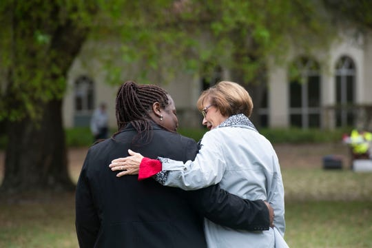 Jackie Gary Clarke (left), village of Indiantown Village Councilwoman, and state Rep. Gayle Harrell embrace during a party celebrating the village's first anniversary of incorporation Saturday, Jan. 26, 2019, at Post Family Park in Indiantown.