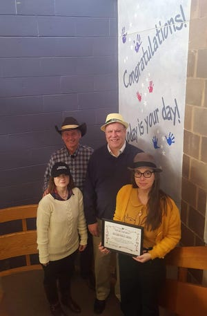 Carmen Trinidad (front row, left) and Brandi Grosso of Vineland Public Library accepted a Certificate of Appreciation for support of Project Santa's Angel Tree and Boys and Girls Club of Vineland's recent successful, holiday party. Chris Volker (back row, right), director Boys and Girls Club of Vineland,and Alex Kaganzev, coordinator of Project Santa, and board member, Boys and Girls Club of Vineland, presented the certificate. The photo was taken on National Hat Day!