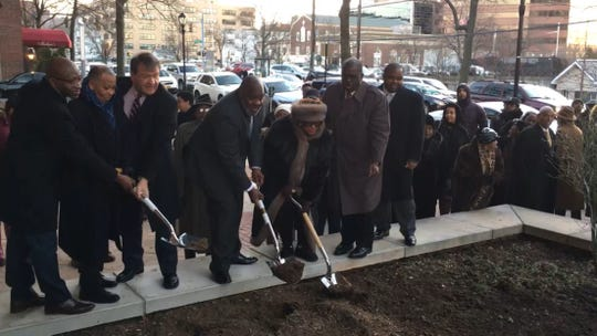 Stanley Ridley and Felita Rucker Bouche, center, ceremonially break ground for a monument to their son Christopher Ridley, an officer who was killed while off duty in White Plains in 2008. They are joined, from left to right, but Westchester County Legislator Lyndon Williams, legislature Chairman Ben Boykin, County Executive George Latimer, Deputy County Executive Ken Jenkins and Legislator Chris Johnson on Jan. 26, 2019.