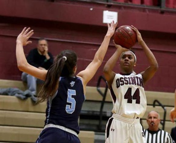 Aubrey Griffin of Ossining shoots over Sonia Cintron of Ursuline during a varsity basketball game at Ossining High School Jan. 25, 2019. Ossining defeated Ursuline 77-64.